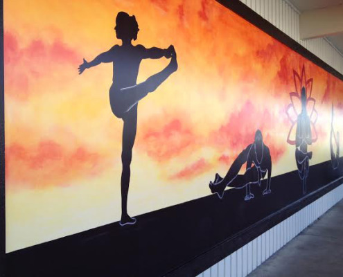 murals trompe l'oeil doorways and views Graphic Silhouette Hot Yoga Mural At The Ashram Studio in Kirkland sunset yoga postures mural artist murals Tacoma
