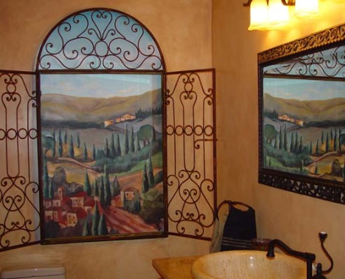 Tuscan Hillside Mural in Powder Room Redmond Interior design ideas mural painter iron shutters pedastool sink landscape Seattle murals trompe l'oeil doorways and views