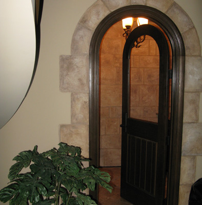 venetian plaster italian plasters Faux Stone Archway around Wine Cellar Olympia plaster interior designers idesa Seattle Bellevue
