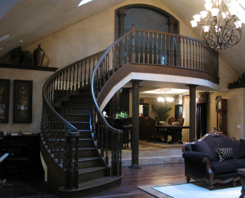 Architectural Faux Finish Entry Bellevue rounded stairwell wood and travertine floors old world walls