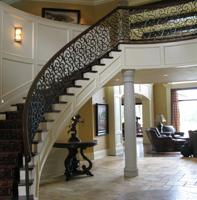 venetian plaster italian plasters French Chateau Plaster Entryway Bellevue interior design decorative finishes Seattle spiral staircase travertine floors